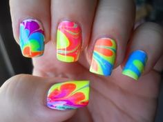 Nail Art  You put water in a bowl and drop random colors of nailpolish in it. then you stir it with a toothpick and put petroleum jelly on your fingers, so that the nail polish only gets on your nails. then you stick your fingers in the bowl.