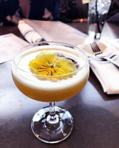"Sunday drinks include flowers, obvi. ""Passionate from Miles Away"": vodka, aquavit, aperitivo, passion fruit, lemon."