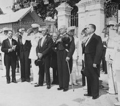 After the U.S. Occupation. It's 1941 and Elie Lescot (the one with the hat thrown over his left shoulder) is standing in front of the Palais Legislatif (Congressional Palace, in other words) with members of his cabinet, and some gentlemen from the army. To the left of the president is Charles Carrie, his Chief of Protocol. Vely Thebaud, his Minister of the Interior, is the fellow to his left.