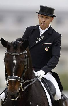 Steffen Peters, of the United States, rides his horse Ravel, during the equestrian dressage competition at the 2012 Summer Olympics, Tuesday, Aug. 7, 2012, in London. (AP Photo/David Goldman)