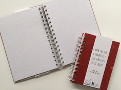 Handmade notebook in red version of Buku Kami Project, which is made of recycled paper and made by former trafficked women