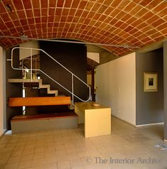 In the open-plan Jaoul House in Paris the vaulted ceilings are constructed from brick and the floors are lined in palest pink ceramic tiles. Photographer: James Mortimer Designer/Stylist: Le Corbusier Architect: Le Corbusier