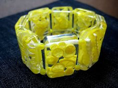 crystal resin stuffed with polymer clay lemons - bracelet by Anna Jour, via Flickr