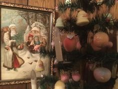 Old print of Santa. Candle lights and cotton ornaments on the goosefeather tree.