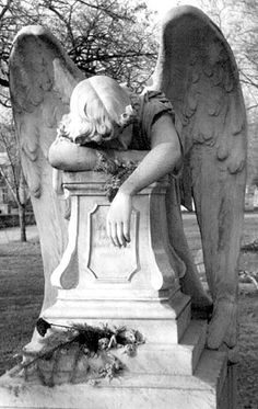 this just makes my heart weep, the pain of loss... Cemetery Art Photography by Roger Hall, The photos of the cemetery statues in this gallery were taken in Germany, The Czech Republic, Hungary, Minnesota, and Costa Rica.