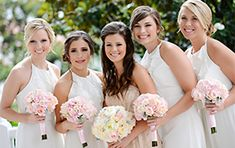 Mix up the traditional - bridesmaids in white dresses and the bride in a blush gown