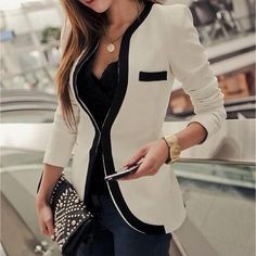 Dark jeans, black top and cream blazer!