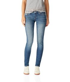 """Tug on our Bayla Skinny Core Medium Wash Jean for cool style in a snap! Zippered fly closure. 99% cotton, 1% spandex. Machine wash/dry.<br><br>Medium wash<br>Signature skinny fit<br>Authentic stitching<br>Slim through the thigh<br>Whiskering and fading through the knees and thighs<br>Stretchy fabric<br>13"""" leg opening<br>Approx. inseam (6R): 32""""; Rise: 8""""<br>Model Height: 5'9"""" Size: 3/4 Regular.<br>Style: 0276. Imported."""