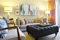 This is a time-honored arrangement: a sofa and two chairs at a 90-degree angle with a side table serving both. A large upholstered ottoman d...