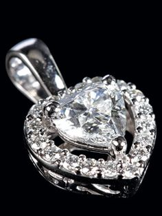 Lustrous And Resplendent Solitaire Studded With Diamonds In The Shape Of A Heart. A Pendent To Tell Her She Is The Best Woman In The World.