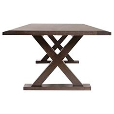 X-shaped dinning table by Christian Liaigre for Holly Hunt. Excellent table for dinner parties. Can fit 10 people comfortably.     12 available dining chairs will be sold separately that fit the dimensions of the table. Please email: support@chairish.com for more information.