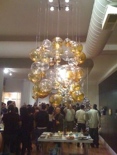 The jawbreaker chandelier was inspired by a chandelier I made using glass balls in my own Chicago loft space.
