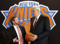 Mar 18, 2014; New York, NY, USA; New York Knicks new president of basketball operations Phil Jackson (right) talks with Madison Square Garden chairman James Dolan at a press conference at Madison Square Garden. Mandatory Credit: William Perlman/THE STAR-LEDGER via USA TODAY Sports