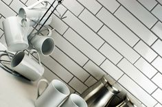 Toto Mosaic Tiles - White Multi Brick.  A unique gloss white brick shaped mosaic tile on a mesh netting. Create a brick effect wall the easy way with these Multi-Brick Gloss White Mosaic Tiles. The size of the bricks are 195x45mm and 95x45mm. Ideal for use as a kitchen splashback or bathroom wall, these ceramic mosaic tiles offer unbeatable value to create a stunning individual design.  Only £0.99p/Sheet!