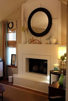 Light my Fire: Mantles Galore - Remodelaholic....i may have pinned this one already but I love the board and batten pattern with the mirror