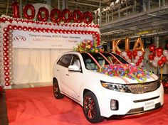 Kia Motors Manufacturing Georgia, Inc. (KMMG), the plant that produces the Kia Sorento crossover and Optima sedan, celebrated (July 14th) as a Snow White Pearl 2014 Sorento SXL rolled off the assembly line at the 2,259-acre site, marking the one-millionth Kia to be produced on US soil. *Courtesy of Auto Blog