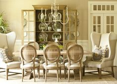 Stephanie Shaw Design 2013 Greige Dining Room, Belgian linen wing chairs, Oval caned back dining chairs, Reclaimed wood dining table, Aiden Gray chandelier, Neutral grasscloth walls, Green accents, Ikat pillows, Natural Interiors