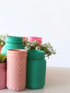 spray painted mason jars with planted flowers