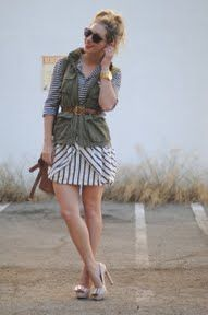 Two types of stripes under a military-style vest. The picture doesn't show it, but she also pinned vintage brooches to the vest