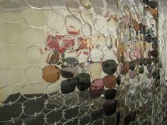 """Kylie-Fleur's """"Self-Replication"""", an   Installation of thousands of recycled optical lenses, intricately held together using nylon knots, forming what appears as a pair of curtains suspended from the ceiling by a curtain rail!"""