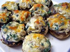 Mushrooms Stuffed With Spinach and Cheese from Food.com:   These are a great Appetizers or you can make a Meal out of them!