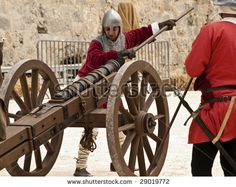 Present: Knights firing a cannon during medieval reenactment in the old city of Mdina in Malta April 19, 2009  (Shutterstock, 2003 - 2012)