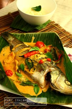 Grilled Seabass in banana leaf with Thai red curry