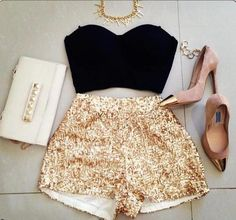 High waisted sequin shorts, black bustier, gold cross chunky necklace, golden toe heels, clutch with gold studs.