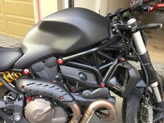 Right side 2015 Ducati Monster 821 Dark full Carbon FIber loaded. Carbon fiber tank belt covers and exhaust shields. Red accents with bolts and Nuts.