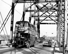 A British double-decker bus has to squeeze itself over the Ak-Sar-Ben bridge in Omaha on a promotional tour of the United States in this October 1964 photo. The bus swung through Omaha for a Brandeis store-sponsored event called Hail Britannia Far. THE WORLD-HERALD
