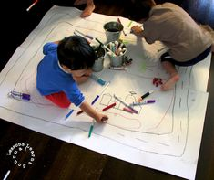 Let them create their own small world play scenes with mega floor doodles. Ask them to tell you about their drawings. You'll love what they have to say.