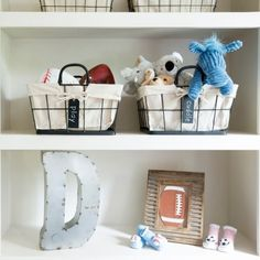 Personal Touch: In addition to storage space, the shelves provide the opportunity to add personal style to the nursery. The metal letter adds a touch of personalization in a more masculine form.