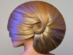 Hair,  as nautilus shell.  Loooooots of hair spray no doubt!