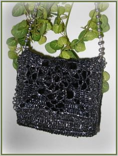 """♥ My Little Black Purse ♥ """"Back In Black"""" Crochet with beautiful shiny ,stable, lightweight, strong and durable VHS Tape....but most of all it sparkles :) Lined with re-purposed black velvet."""