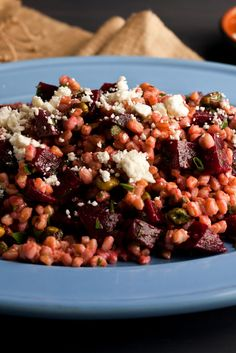 This hearty winter salad can be a meal or a side dish, and warming it in the skillet makes it particularly comforting Cook your farro until you see that the grains have begun to splay so they won't be too chewy and can absorb the dressing properly