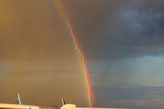 Lightning Hitting Plane Along The Path Of A Rainbow