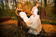 Bride and her maid walking through the leaves