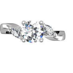 Brilliant Round Diamond set with Pear Shaped Diamonds
