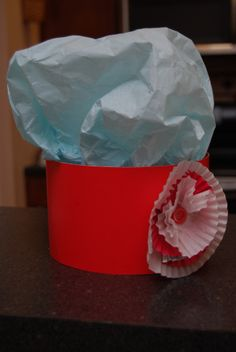 Tissue paper inside construction paper, embellish hats for parties