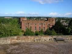 Shrewsbury Castle, a Norman castle built of red sandstone, is in the town of Shrewsbury, England. Apart from the gateway, very little of the building survives.
