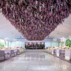 stunning organic flower ceiling under a sustainable fabric tent with vintage chandeliers. donate flowers to a seniors residents after your ceremony to share the joy