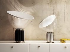 / The Flos Taccia Small Lamp is a new smaller version of the timeless Italian design icon, originally designed by the Castiglioni brothers in 1958. The new proportions complement the classic version and increases the lamp's adaptability.