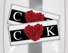 Black and white wedding favors with your monogram and red roses in the shape of a heart. Personalized HERSHEY'S bars will be loved by guests of all ages.