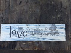 Wooden love makes everything grow sign.