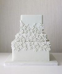 Delicate florals on all white wedding cake