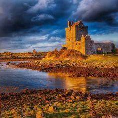 Sunset at Dunguaire Castle in Co. Galway in Ireland. This is a 16th century castle that was built to defend Galway Bay. It is also the most photographed castle in Ireland and you can see why. We showed up close to sunset and were treated to a magnificent  dramatic sky that Ireland is so famous for. One of the many reasons the #wildatlanticway is a drive not to be missed. @tourismireland #ireland by theplanetd