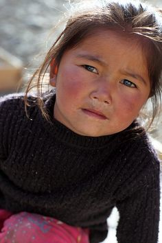 Faces of Nepal.  baby does not trust this whole 'picture taking' thing that you're doing. like stop.
