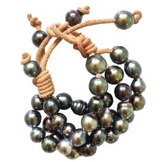 "style ""sixteen"" tahitian pearl bracelet on natural saddle-colored leather cord. by Pearl Love"