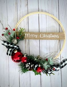See how easy it is to make a simple and elegant DIY Embroidery Hoop Christmas Wreath. Some greenery ribbon and ornaments is all it takes. Christmas Ornament Wreath, Cone Christmas Trees, Noel Christmas, Christmas Projects, Simple Christmas, Coastal Christmas, Christmas Wreath Decorations, Make Your Own Wreath Christmas, Christmas Tables