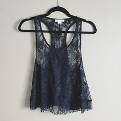 Sheer lace racer back tank Super cute black lace racer back tank top. Forever 21 size medium. Great condition and only worn once. Forever 21 Tops Tank Tops